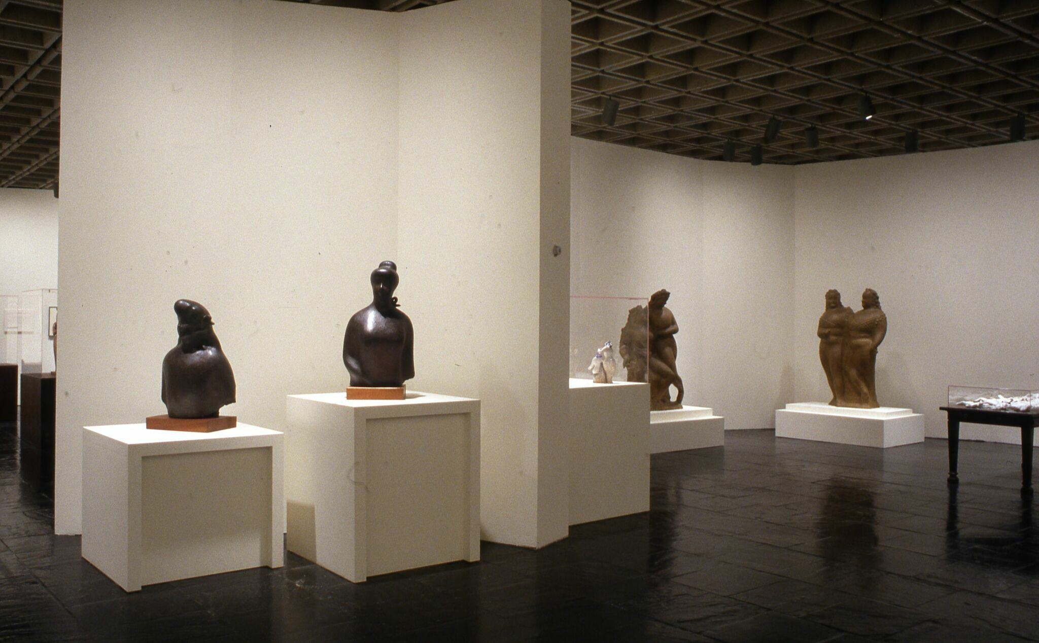 Sculptures displayed in a gallery.