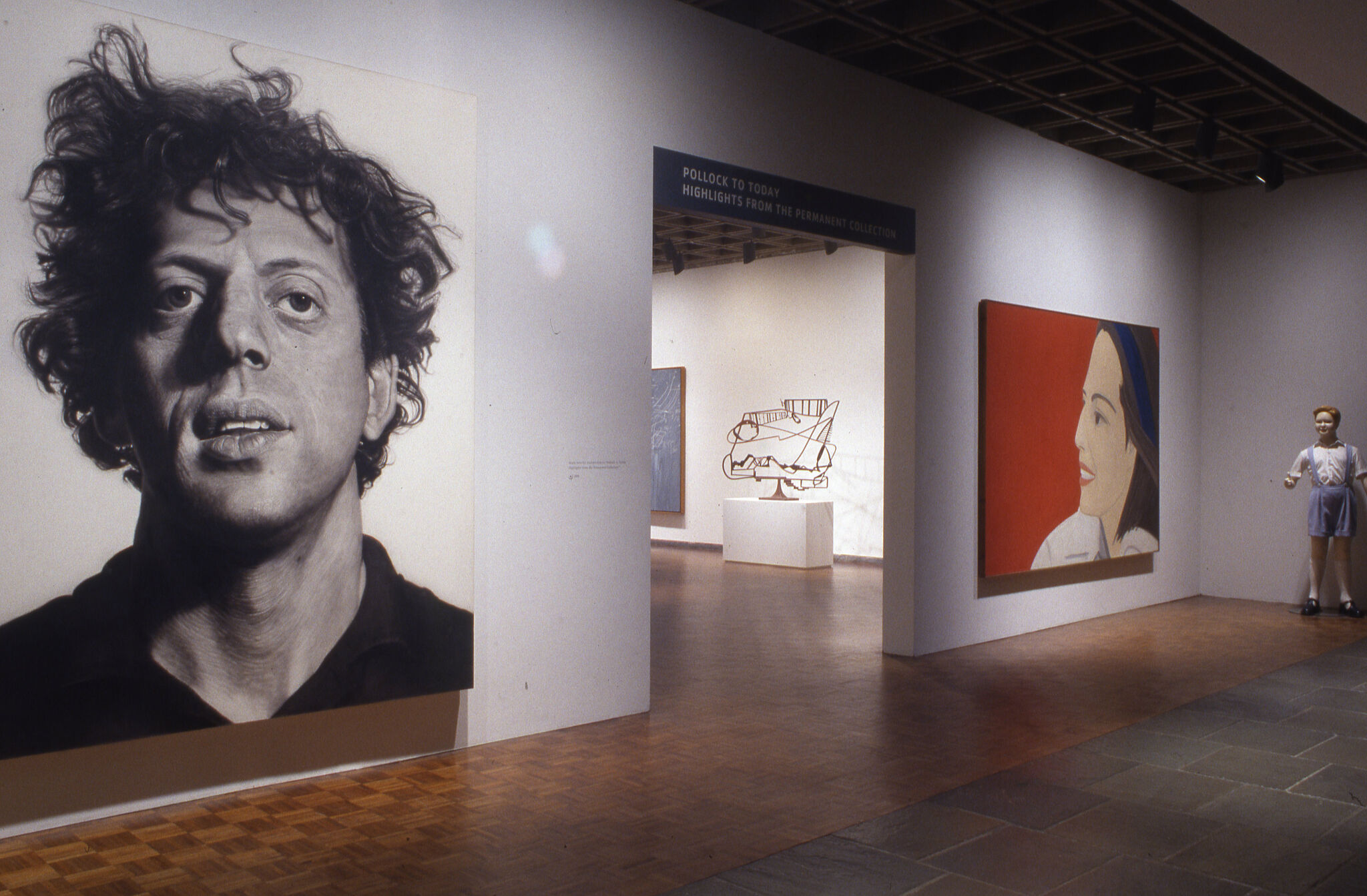 Works of art depicting faces displayed at the entrance of Pollock to Today: Highlights from the Permanent Collection.