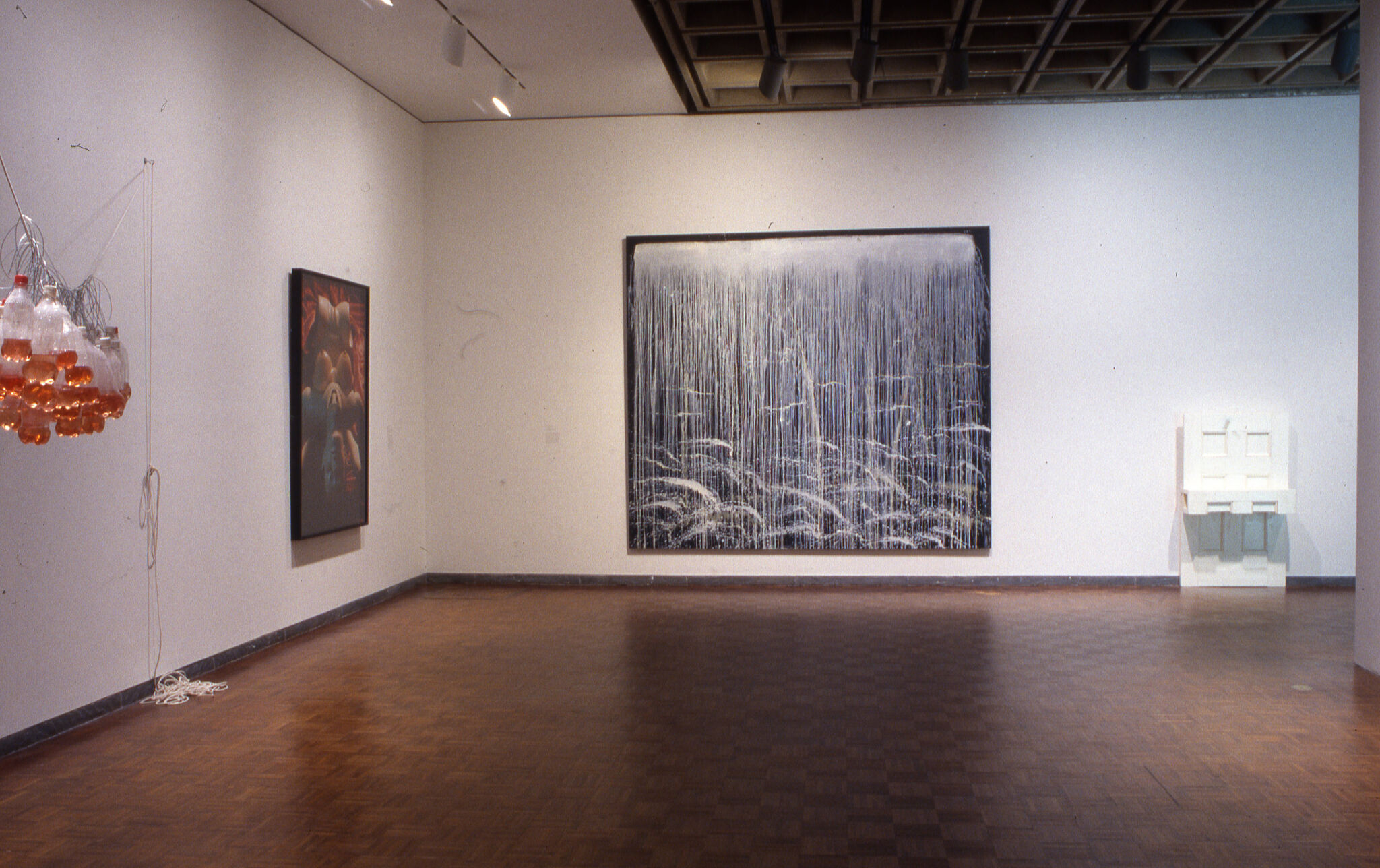 Works of art, including sculptures and paintings, displayed in a gallery.