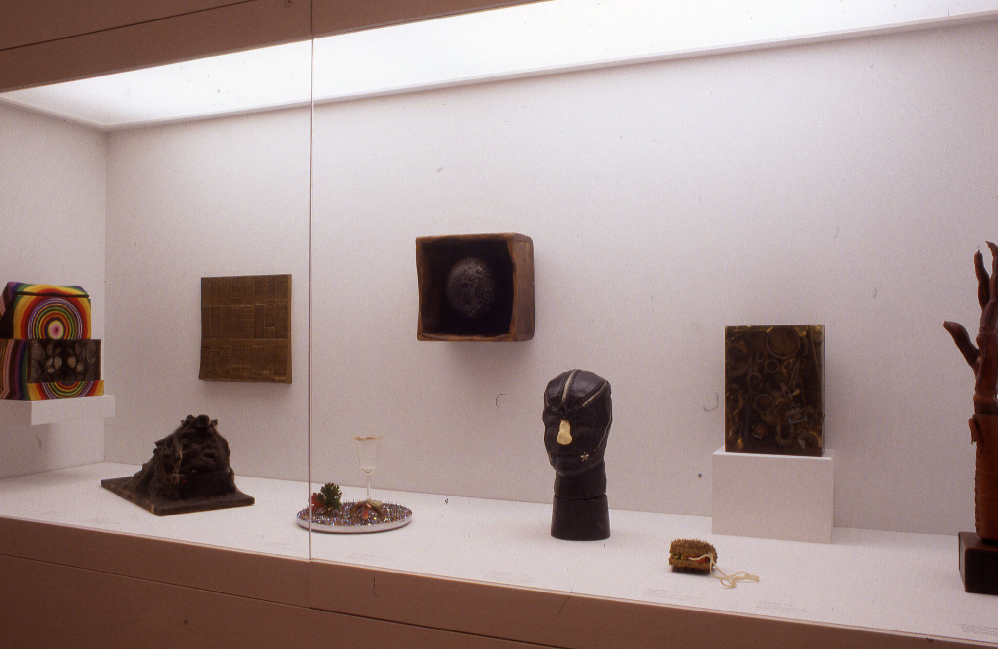 Various sculptures displayed in a glass case.