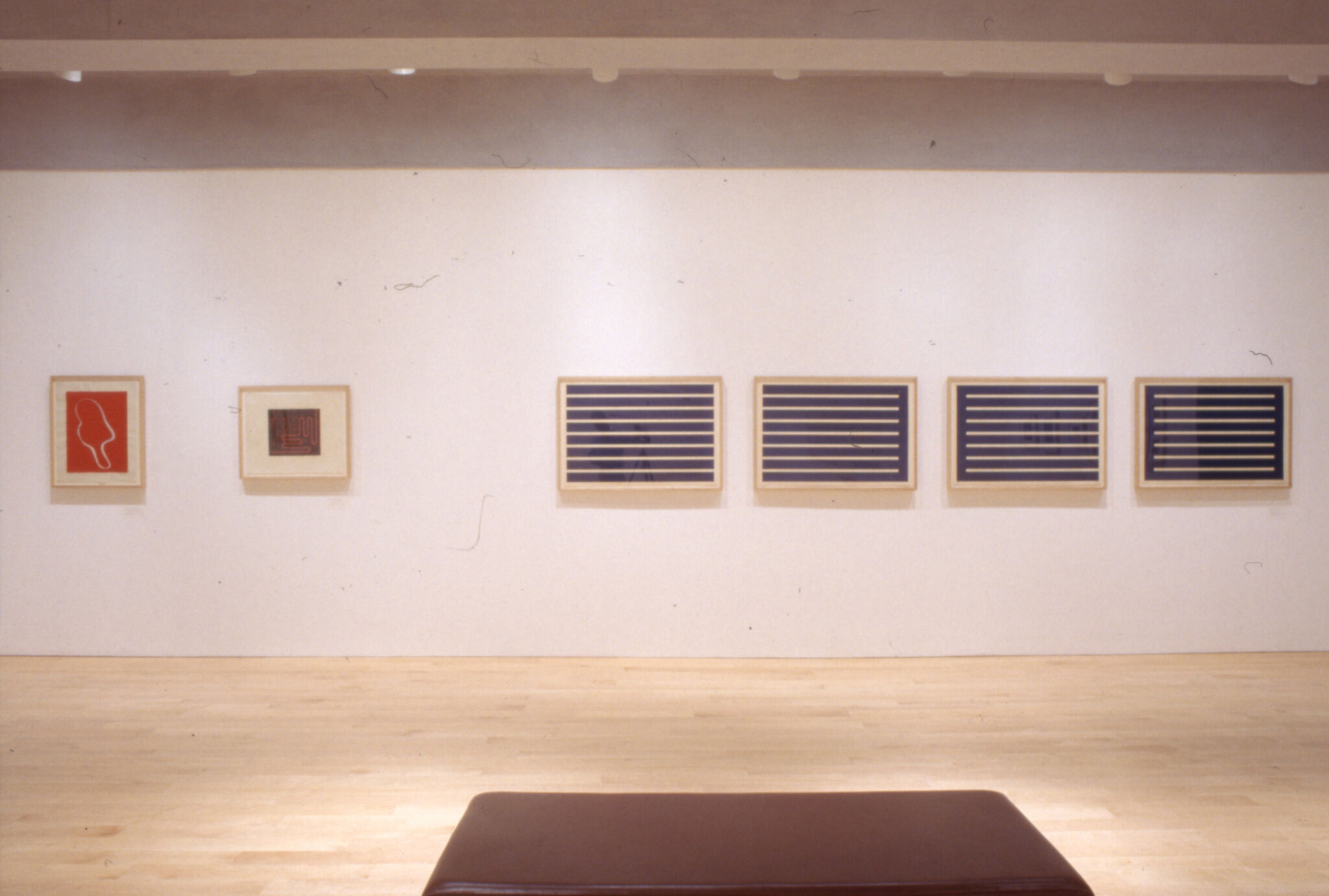 Abstract prints displayed in a gallery.