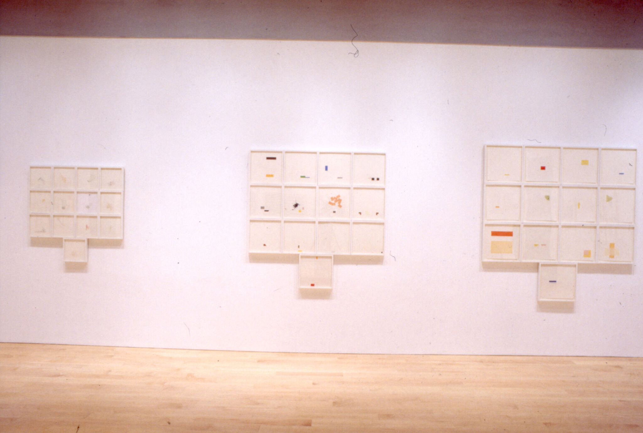 Prints displayed on a wall in a gallery.