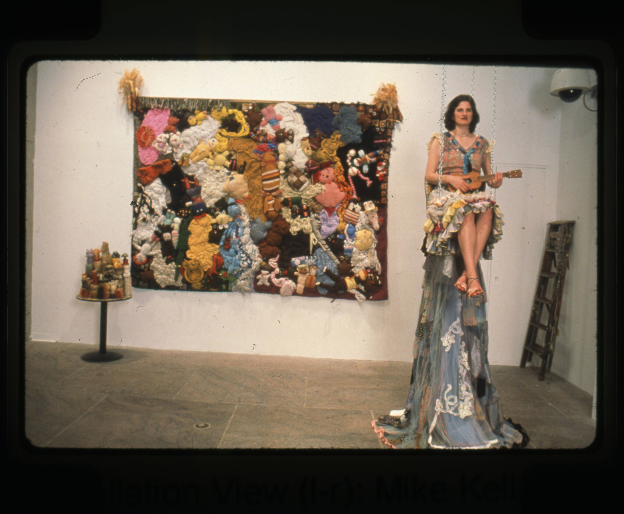 A gallery filled with works of art including a sculpture of a woman holding a ukulele.