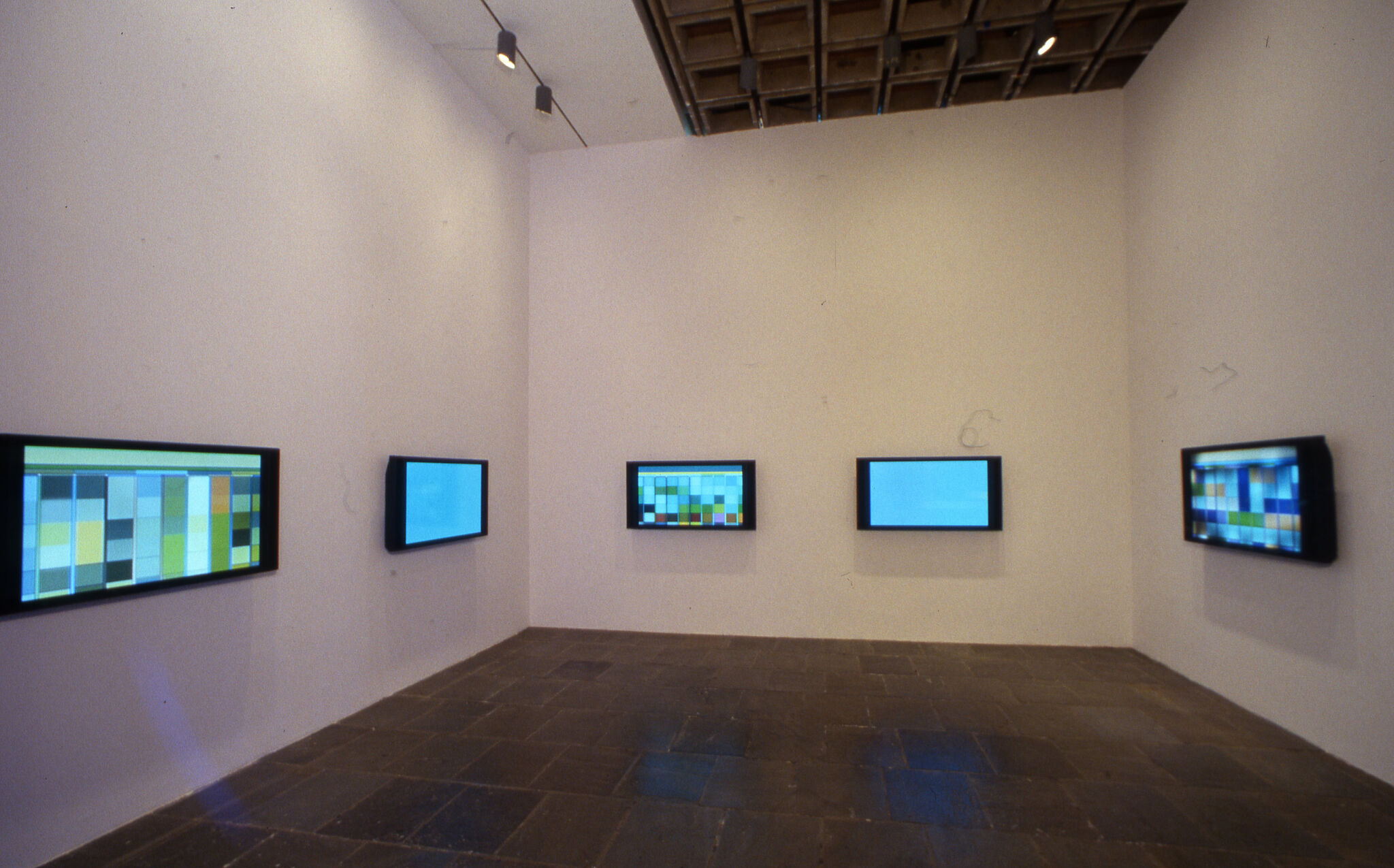 A gallery filled with monitors on the walls.