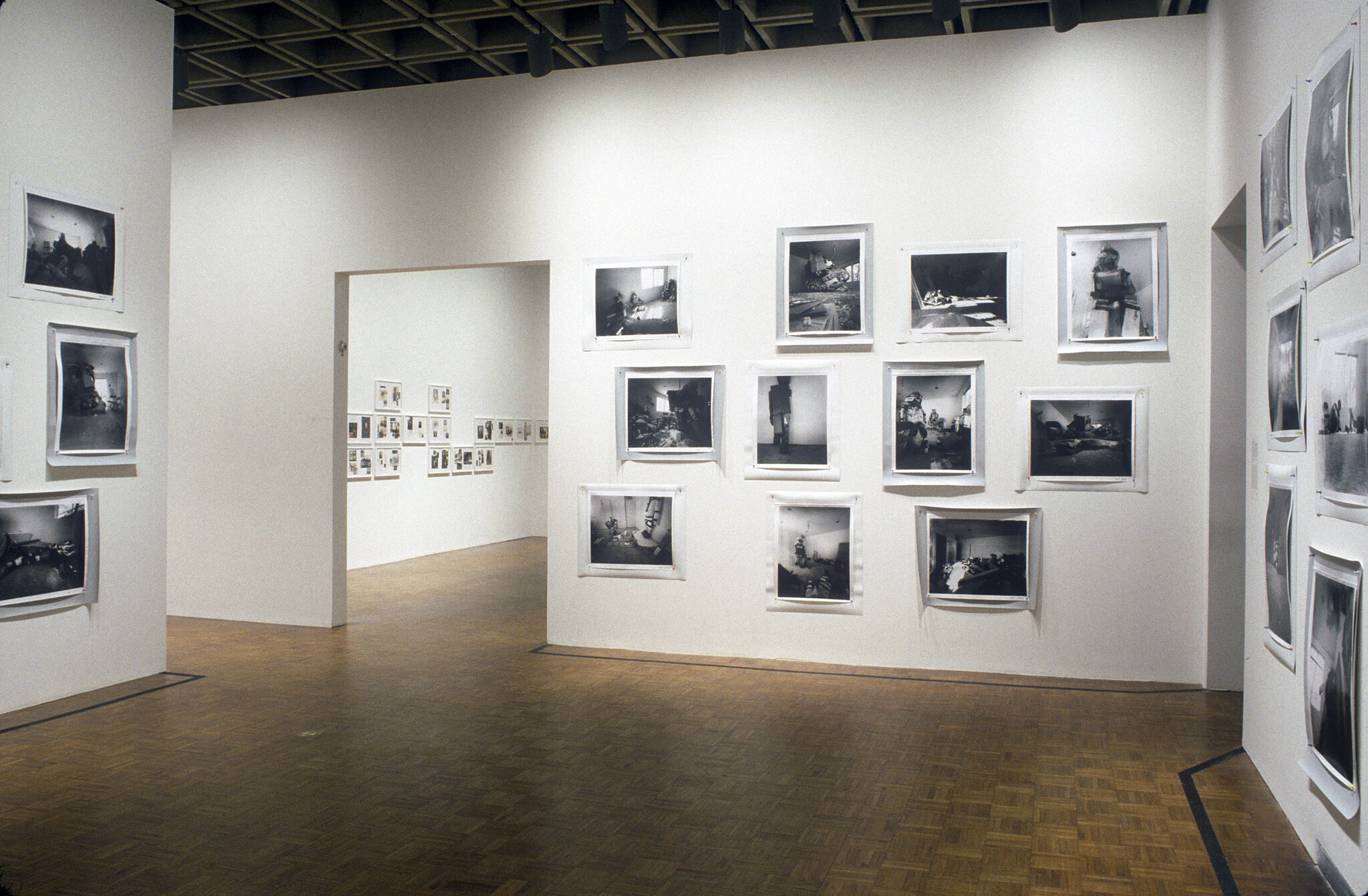 A gallery filled with black and white photographs displayed on the walls.