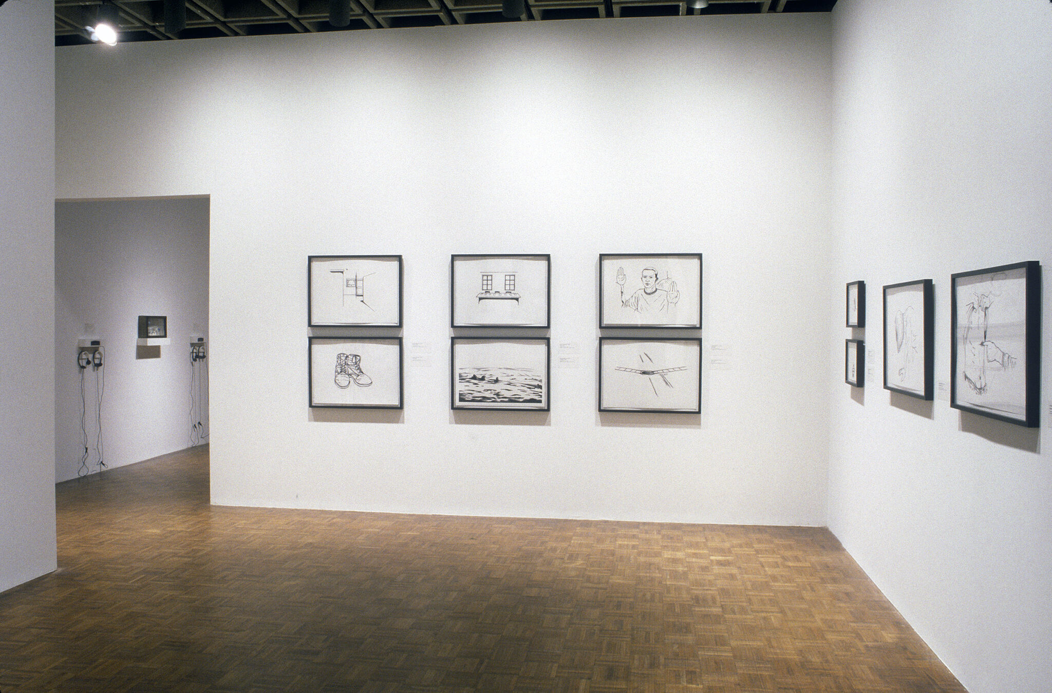 A gallery filled drawings displayed on the walls.