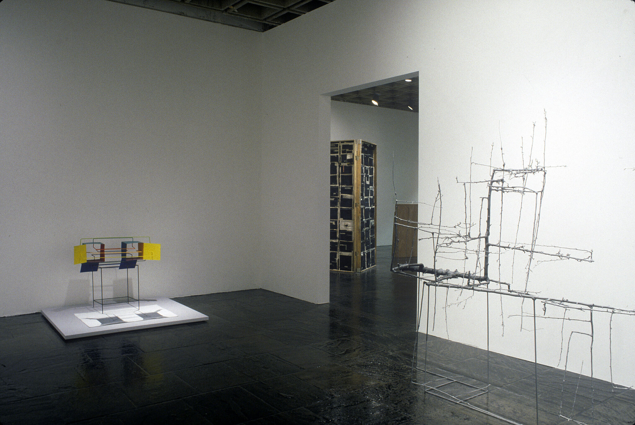 A gallery with wire sculptures on display.