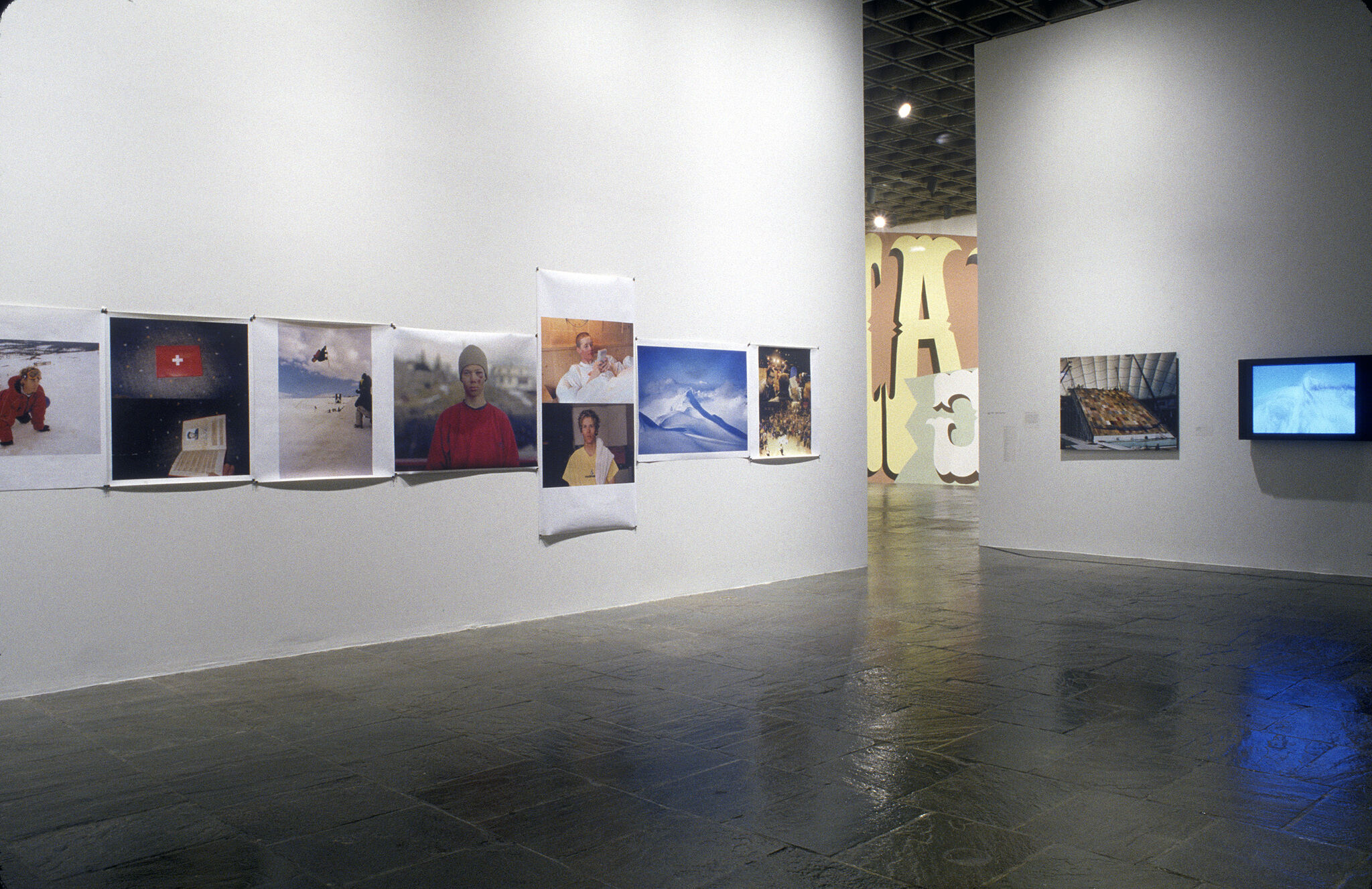 A gallery filled with photographs on display.
