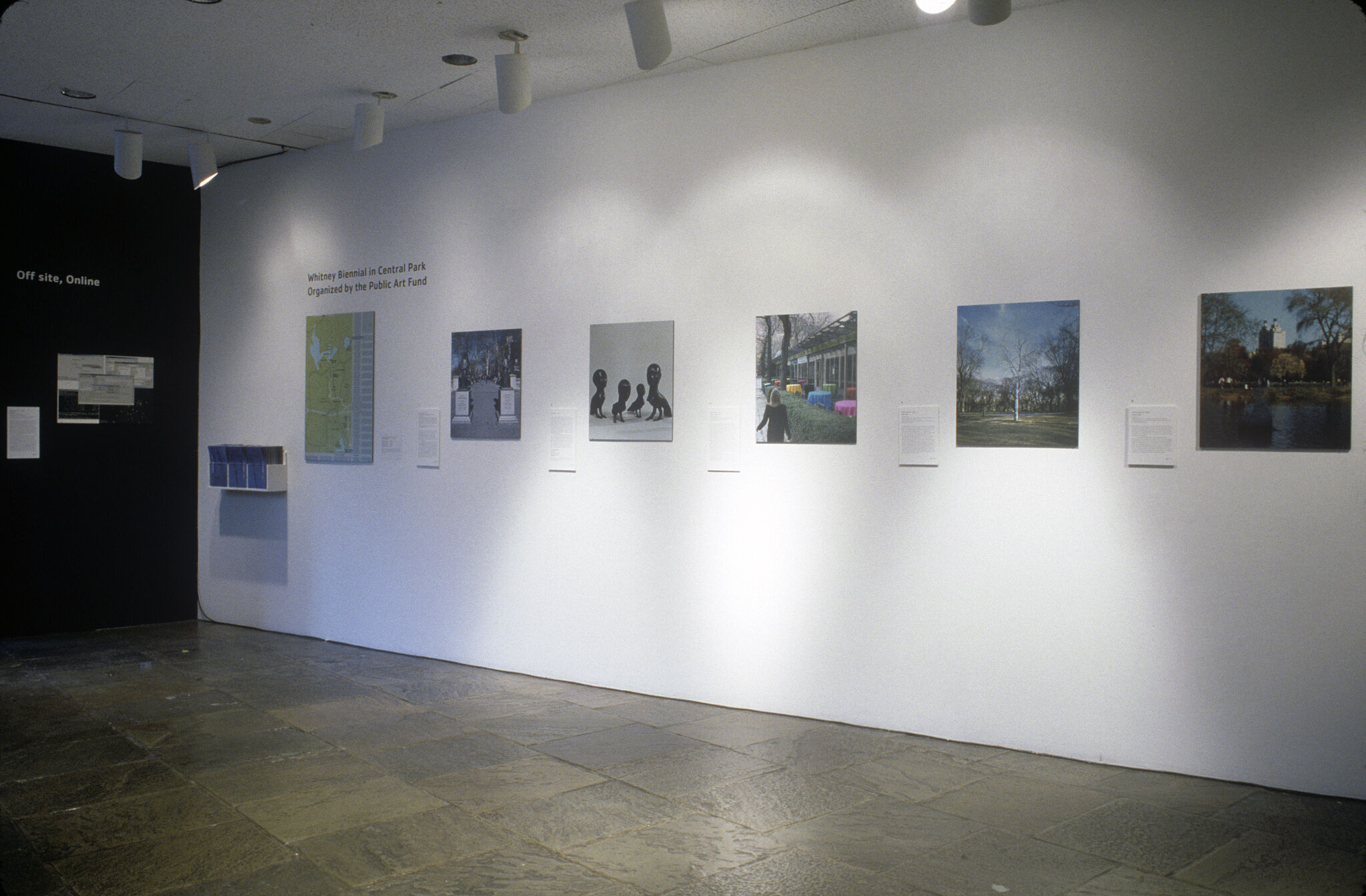 A gallery with photographs displayed on the wall.