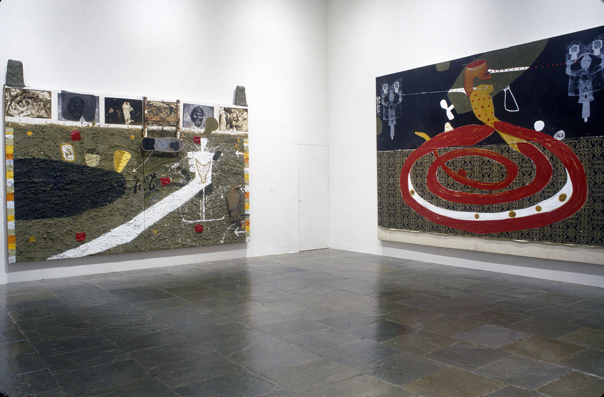 Two mixed media canvases displayed in a gallery at the Whitney.