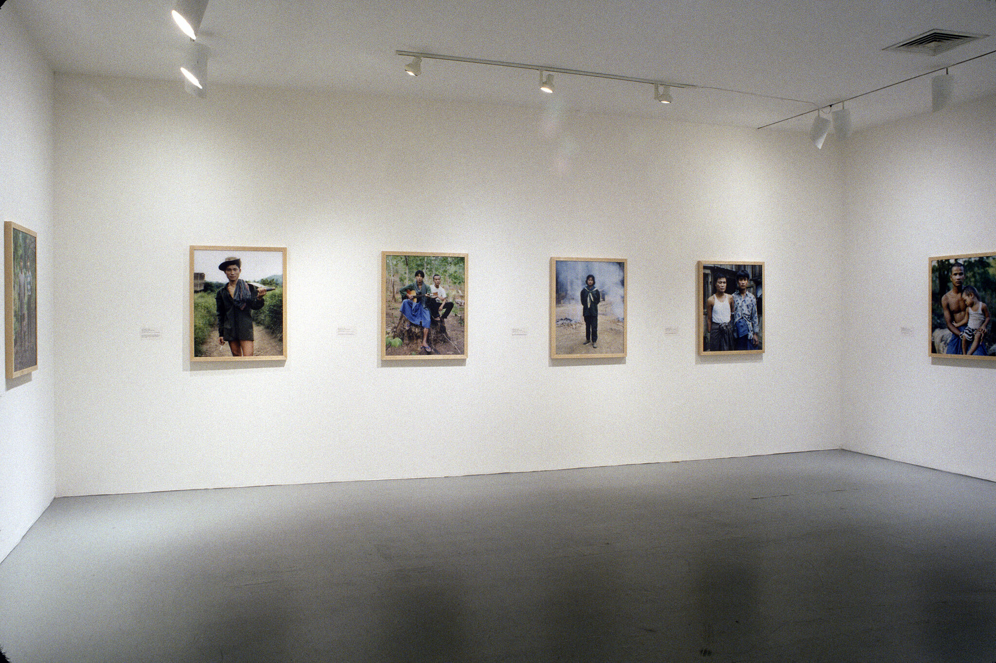 A gallery filled with photographs of people.