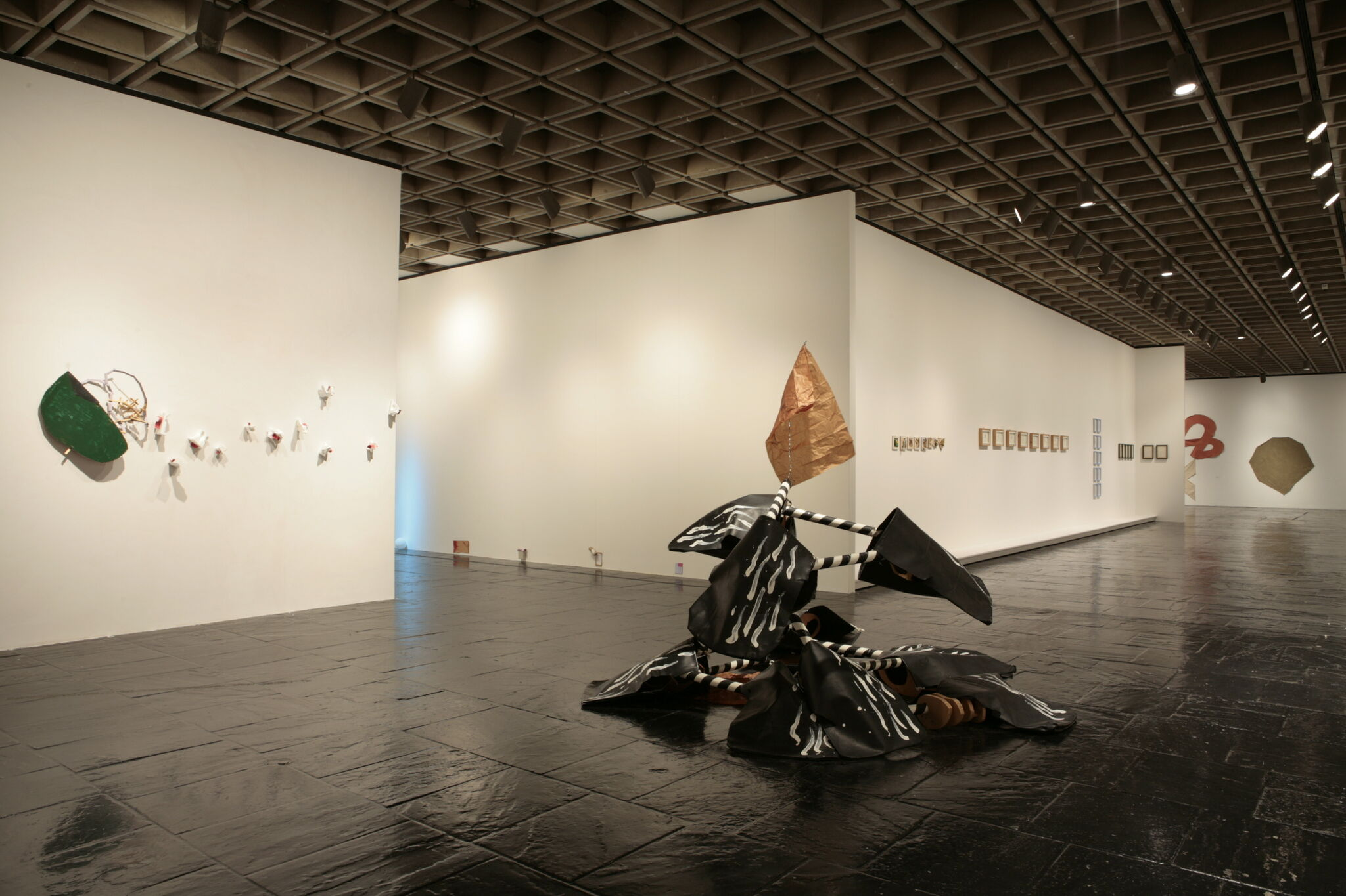 A gallery filled with various works of art, including sculptures and prints.