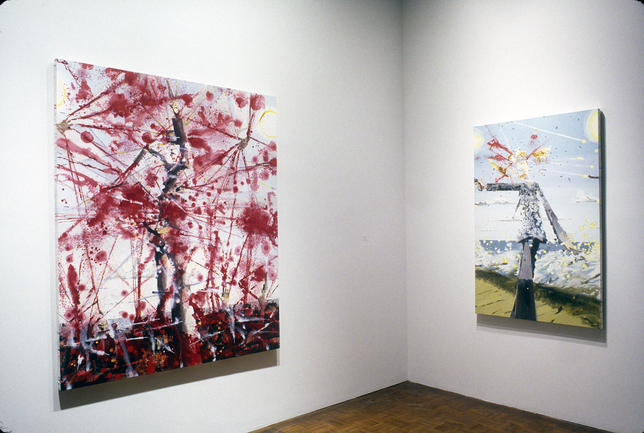 An abstract painting filled with red splatters, along with an abstract painting of a headless figure.