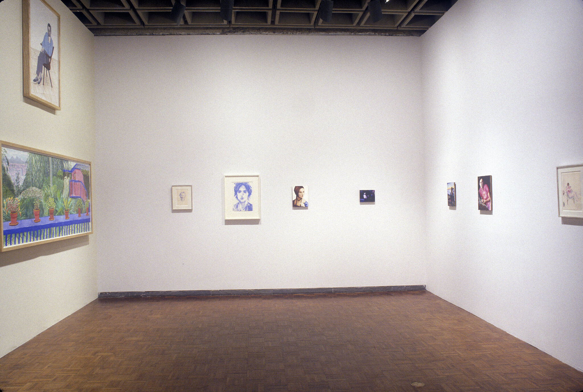 A gallery filled with drawings and paintings.