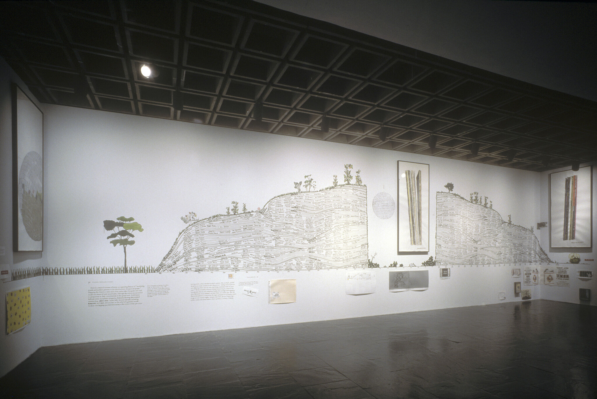 Gallery walls covered in various drawings and text.