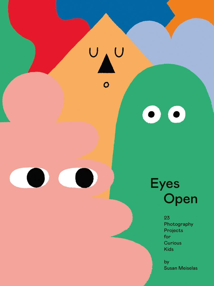 "A book cover with a series of multi-colored shapes that reads ""Eyes Open: 23 Photography Projects for Curious Kids by Susan Meiselas"""
