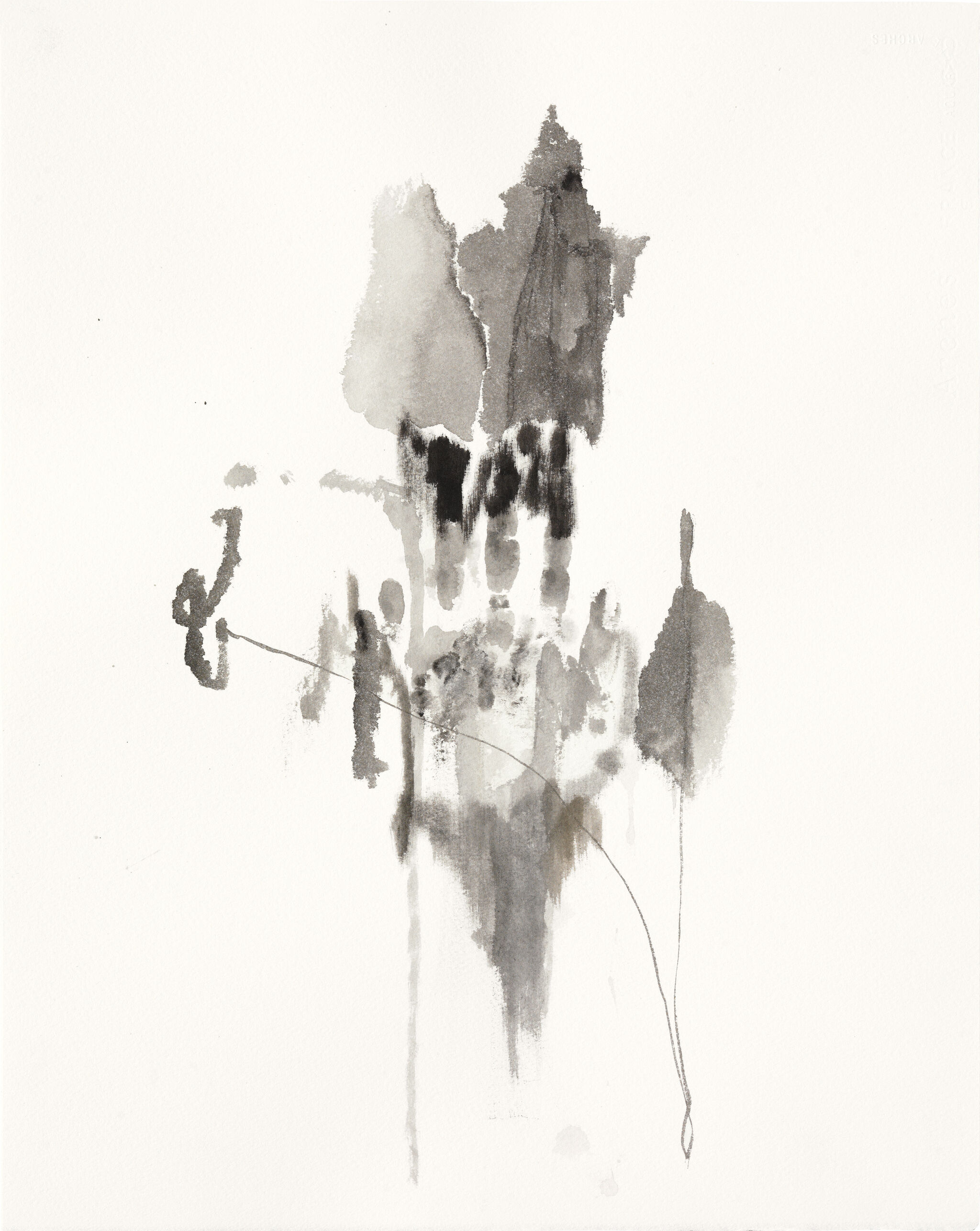 A series of stain-like splotches of ink create an abstract shape in the center of the paper.