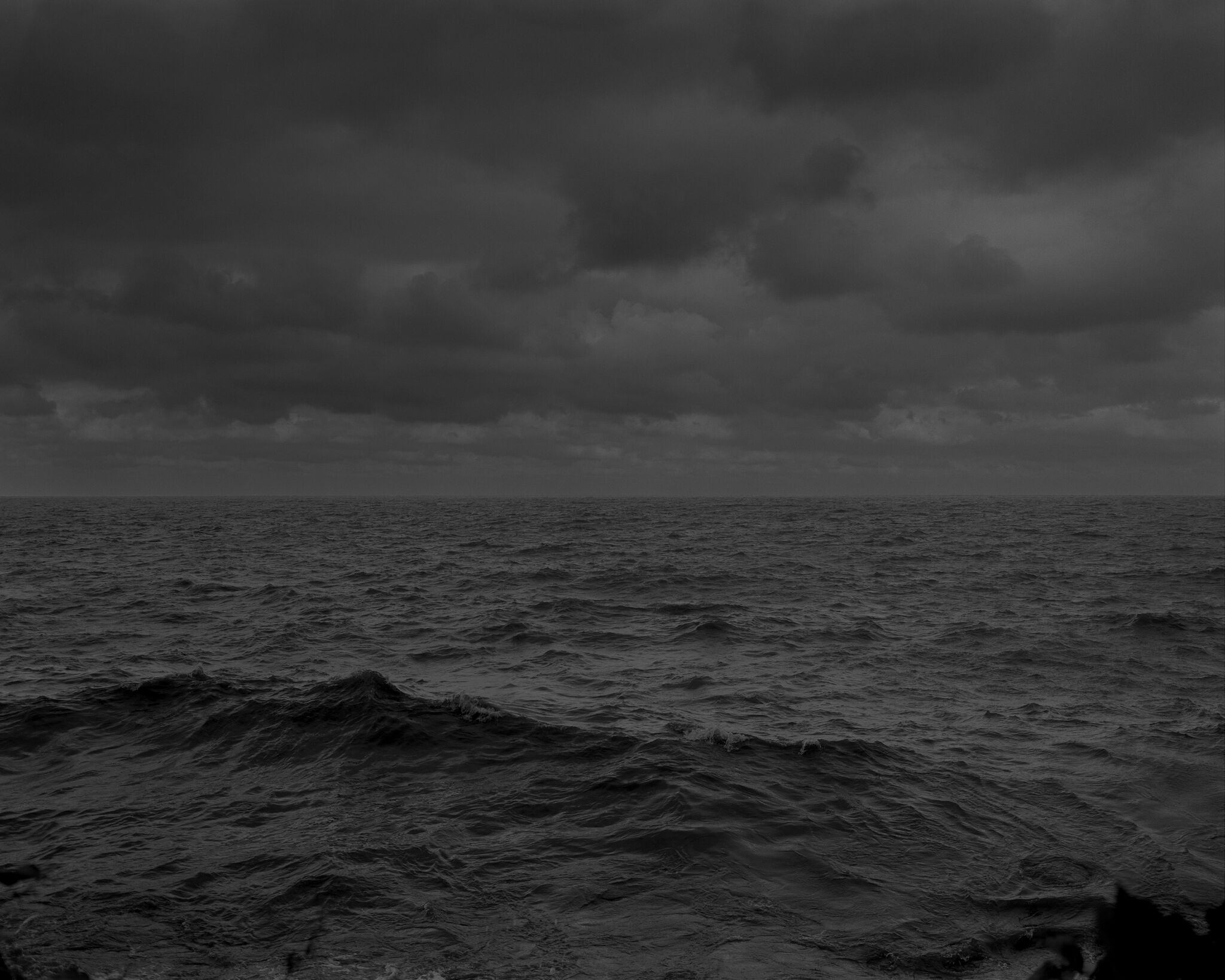 A dark, greyscale landscape shot of Lake Erie.