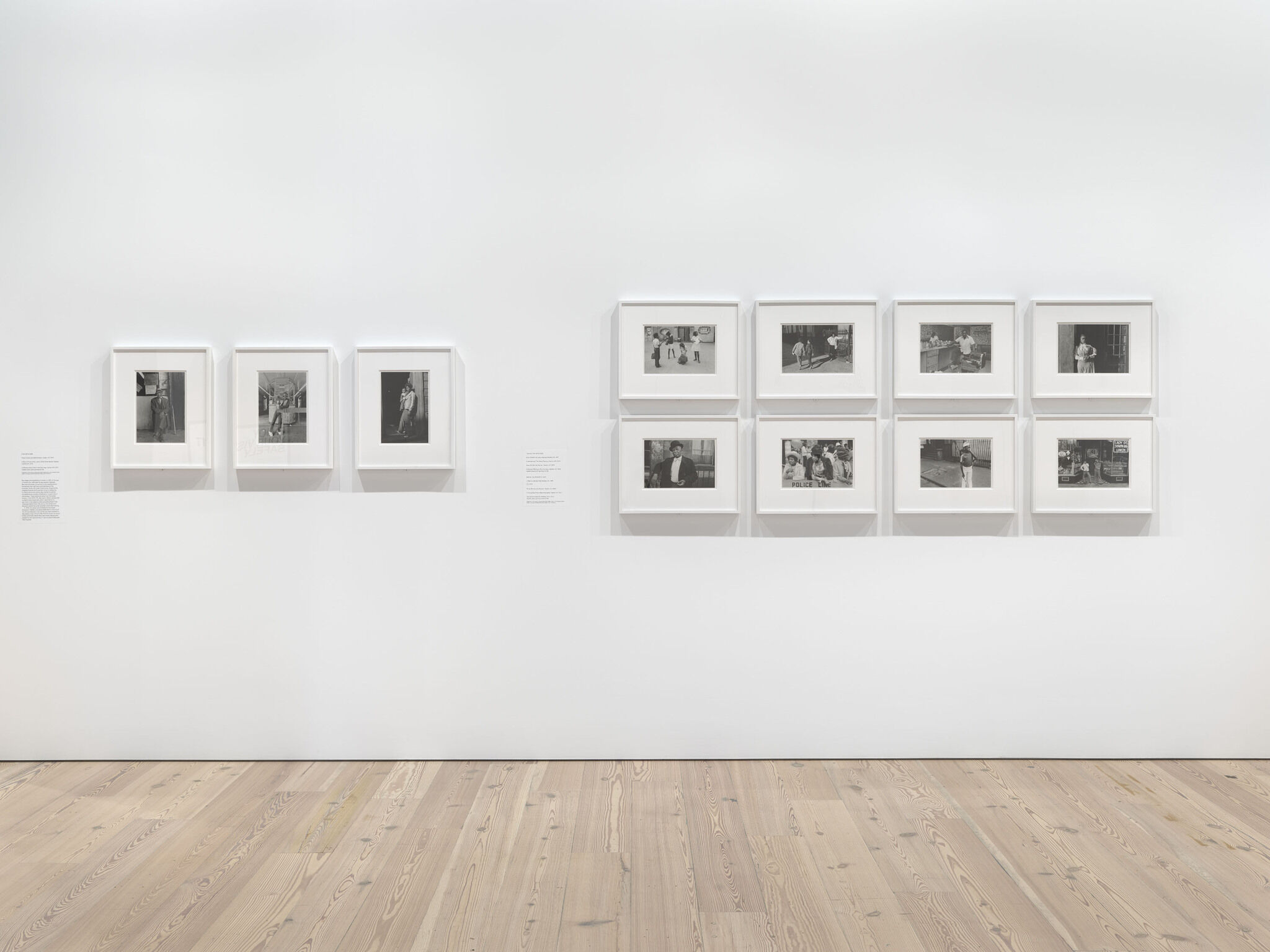An exhibition wall with eleven framed photographs from the Dawoud Bey exhibition.