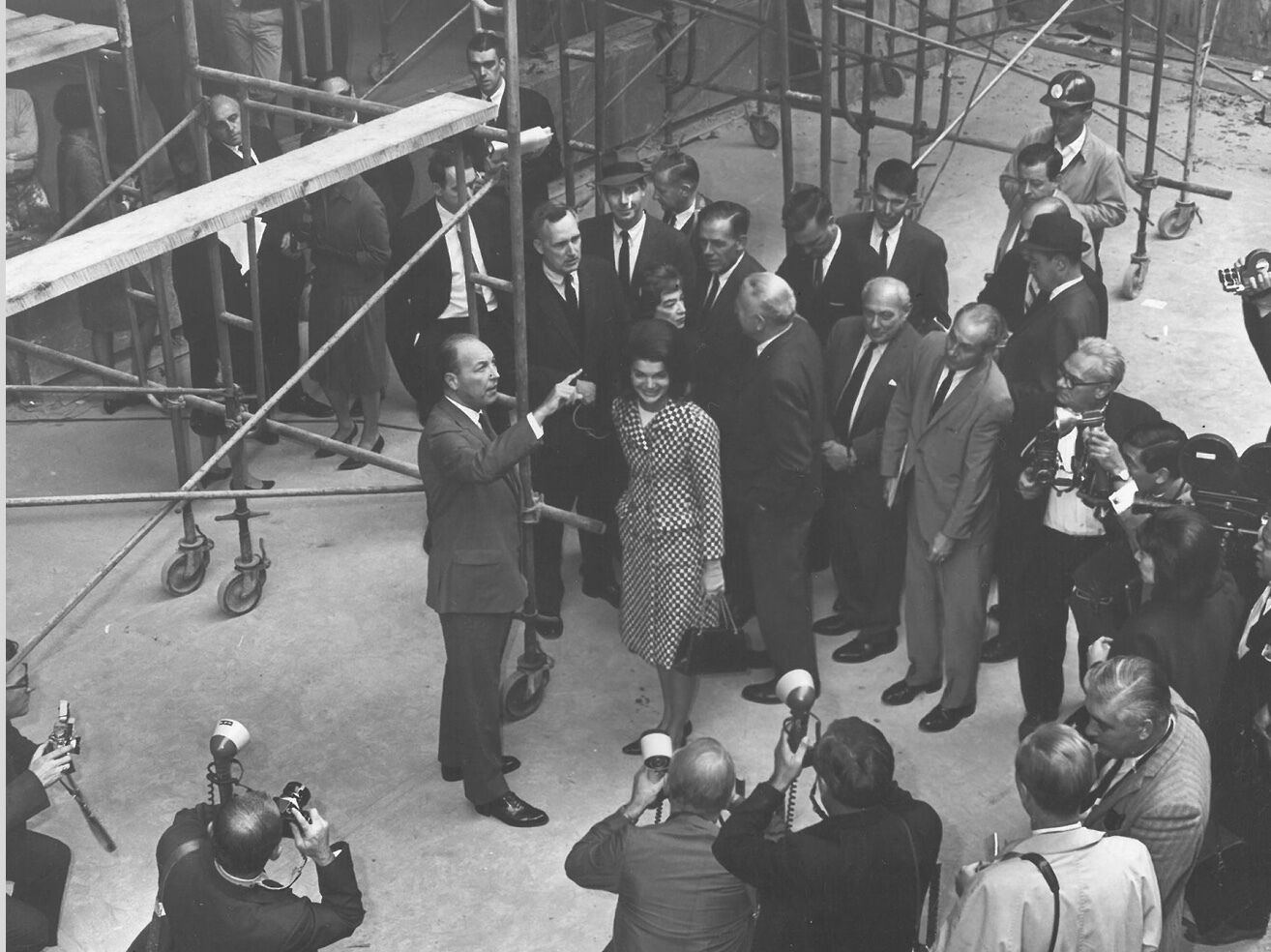 Jackie Kennedy and David Solinger surrounded by a group of people as they tour the Whitney's building site.