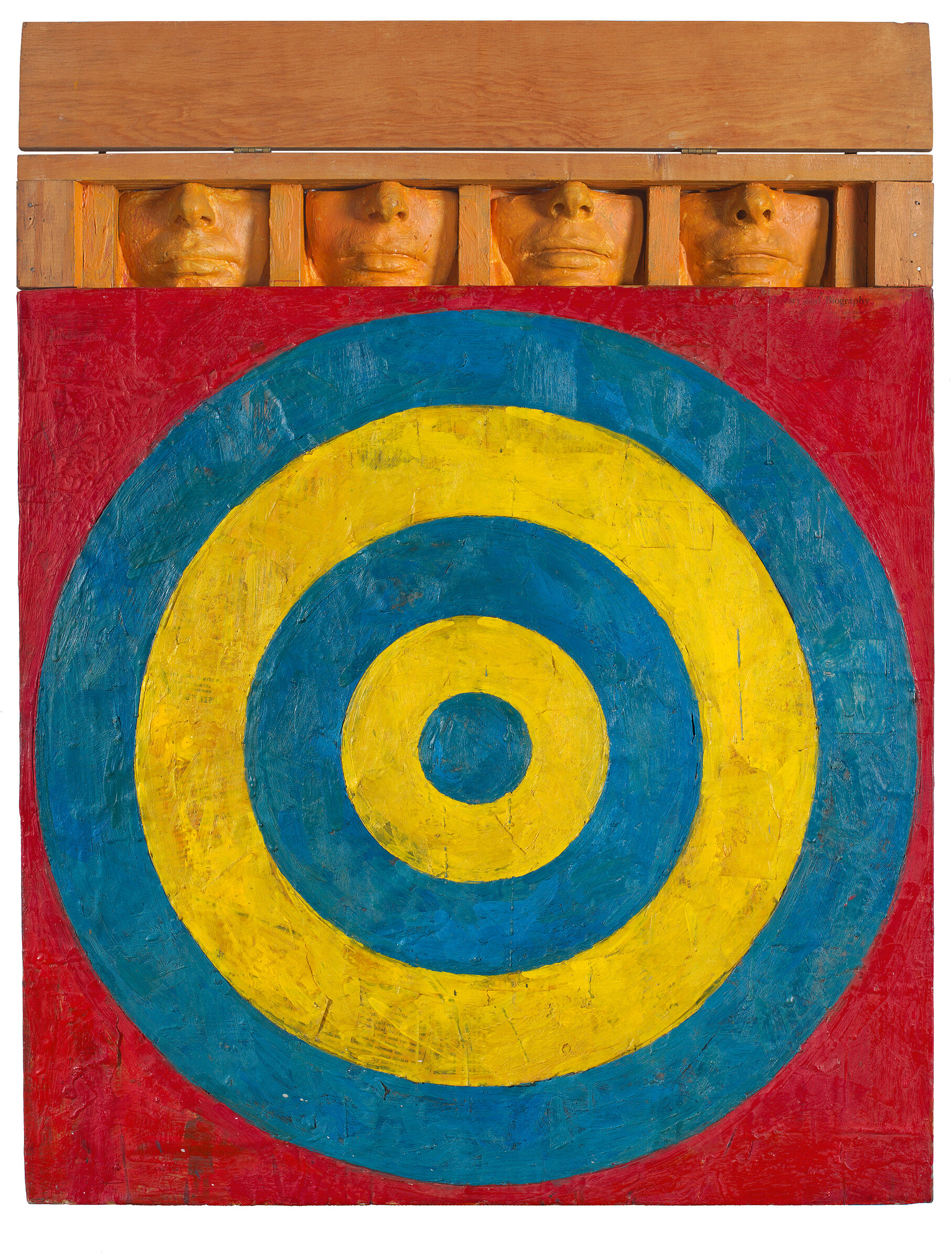 Blue and yellow target on a red background, with the sculpted lower halves of four faces above.
